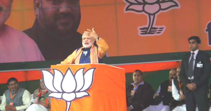 PM_Modi_speaking_at_a_campaign_rally_in_Dwarka,_Delhi